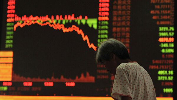 An investor stands in front of an electronic board showing stock information at a brokerage house in Fuyang, Anhui province, July 27, 2015 - Sputnik International