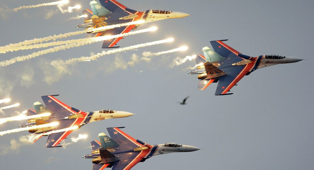 Russian Knights aerobatic team of four Su-27 jet fighters performing at MAKS-2009 international air show