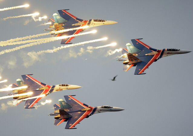 Russian Knights aerobatic team of four Su-27 jet fighters performing at  a MAKS international air show. file photo