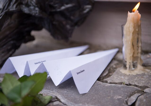 Paper planes and a candle are placed in front of the Dutch embassy in Moscow on July 17, 2015 in memory of the people who died in the crash of Malaysian Airlines flight MH17.