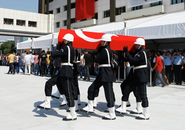 Coffin of police officer Muhammet Fatih Sivri is carried by his fellow officers during his funeral ceremony in Istanbul, Turkey, July 27, 2015. The police officer was killed in clashes in the city's volatile Gazi district on Sunday, the third day of violence there following the death of a leftist activist during police raids on suspected militants.