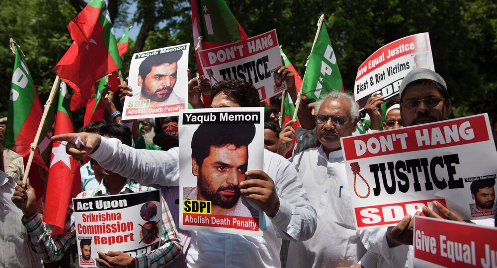 Activists of the Social Democratic Party of India carry placards with portraits of Yakub Abdul Razak Memon, convicted in the 1993 Mumbai bombings, during a protest against his death sentence outside Maharashtra House in New Delhi, India