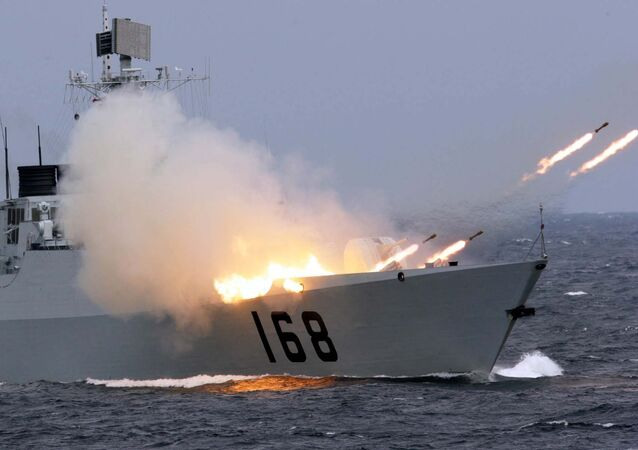 A Chinese naval vessel launches anti-submarine missiles in an offshore blockade exercise.