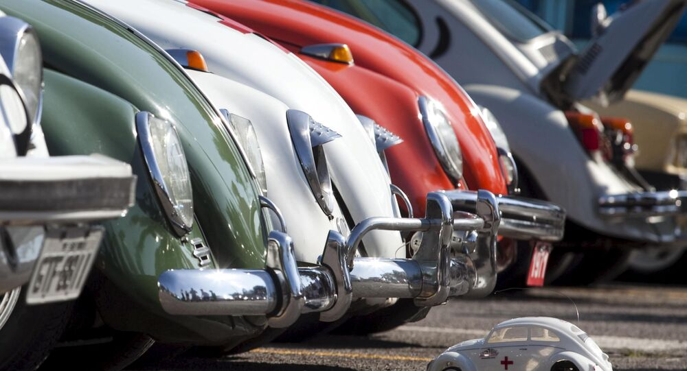 A Volkswagen Beetle toy is seen in front of Beetle cars during celebrations of the National day of the Beetle in Sao Bernardo do Campo in 2011.