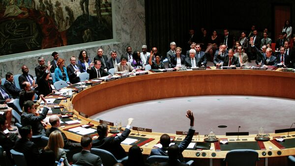 Members of UN Security Council vote on a draft resolution for establishing a tribunal to prosecute those responsible for the MH17 flight during a Security Council meeting at United Nations Headquarters in New York on July 29, 2015. - Sputnik International