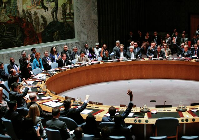 Members of UN Security Council vote on a draft resolution for establishing a tribunal to prosecute those responsible for the MH17 flight during a Security Council meeting at United Nations Headquarters in New York on July 29, 2015.