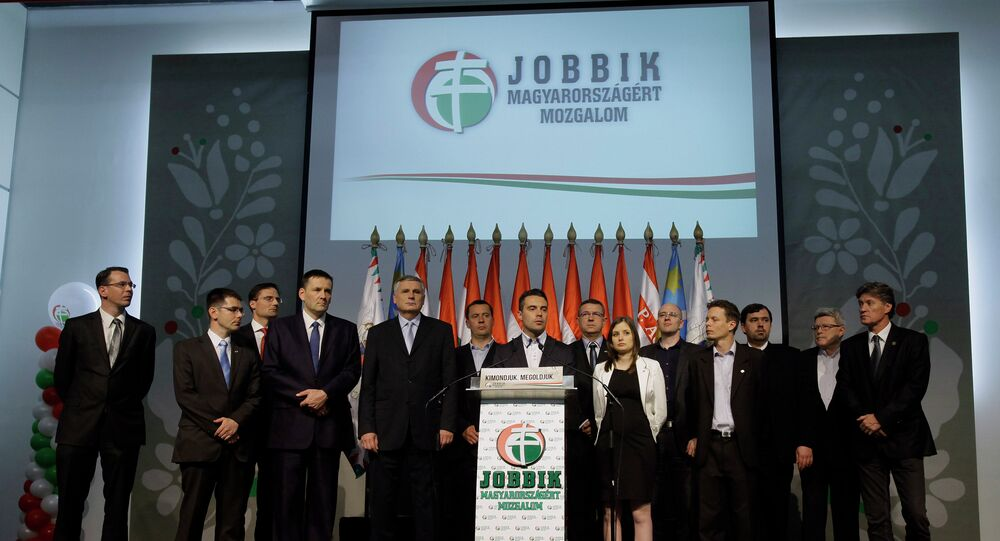 Chairman of the far-right parliamentary JOBBIK (Better) party Gabor Vona (C) reacts for the result of the parliamentary election with his party members at Budapest Congress Center in Budapest. (File)