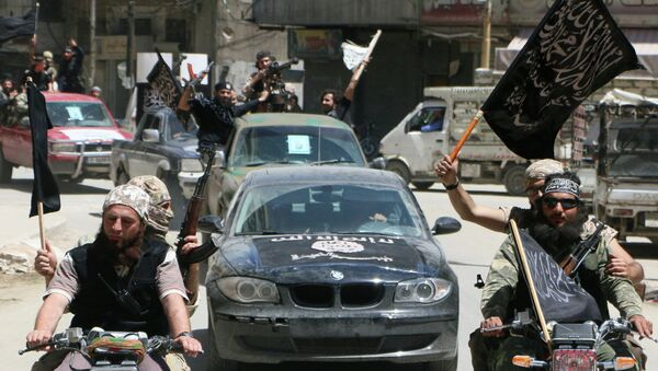 Fighters from Al-Qaeda's Syrian affiliate Al-Nusra Front drive in the northern Syrian city of Aleppo. (File) - Sputnik International