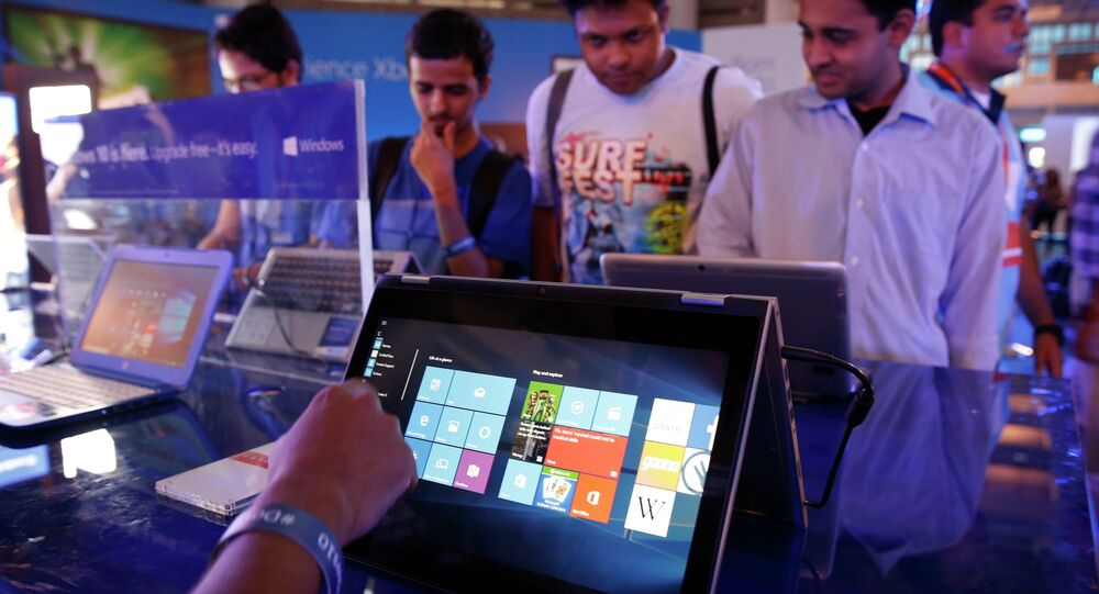 Visitors experience Windows 10 during its launch, in New Delhi, India, Wednesday, July 29, 2015.