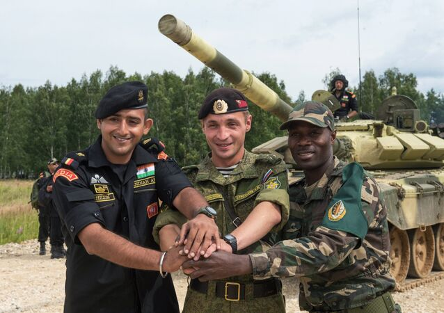 From left: Soldiers from India, Russia and Angola take part in training sessions during the International Army Games-2015 at the Alabino training center in the Moscow Region