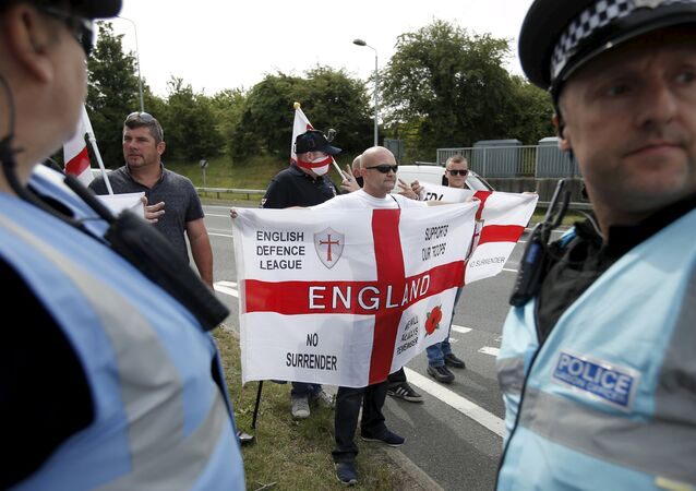 English nationalists take part in a counter-protest aimed at protestors demonstrating in solidarity of migrants in Calais, in Folkestone, Britain