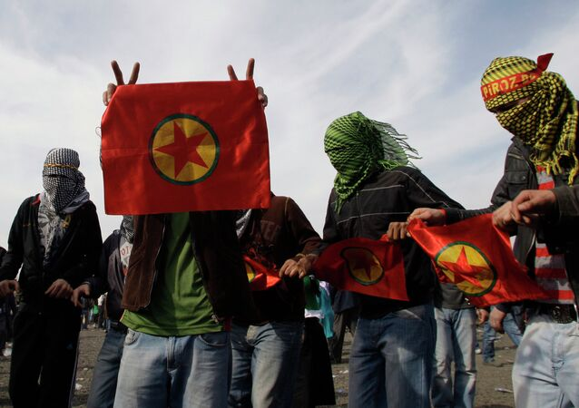 Masked men display flags of outlawed rebel group of the PKK, as Turkish Kurds celebrate the Nowruz in Istanbul, Turkey, Sunday, March 21, 2010. File photo