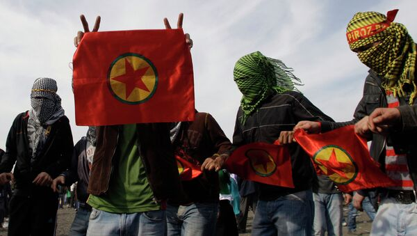 Masked men display flags of outlawed rebel group of the PKK, as Turkish Kurds celebrate the Nowruz in Istanbul, Turkey, Sunday, March 21, 2010. File photo - Sputnik International