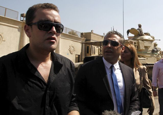 Al Jazeera television journalists Mohamed Fahmy (R) and Baher Mohamed talk to the media outside Tora prison, in Cairo, Egypt, July 30, 2015