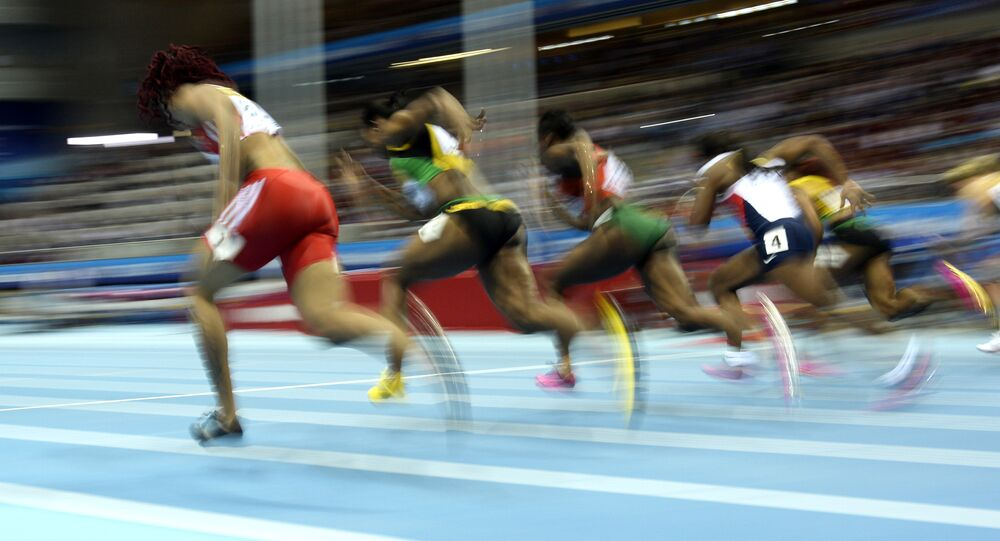Athletes compete in the Women 60 m Final event at the IAAF World Indoor Athletics Championships in the Ergo Arena in the Polish coastal town of Sopot, on March 9, 2014