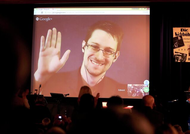 Former National Security Agency, NSA contractor and whistleblower Edward Snowden follows the 2014 Carl von Ossietzky Medal award ceremony by the International League for Human Rights via live video transmission in Berlin, Germany, Sunday Dec. 14,2014