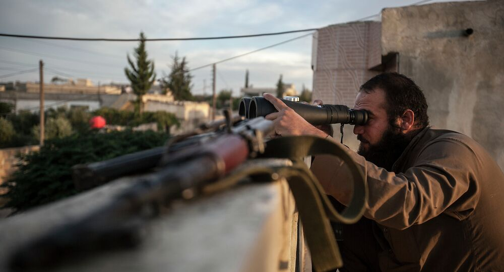 In this Thursday, Sept. 19, 2013 photo, a Syrian opposition fighter watches over as heavy fighting breaks out in in the Idlib province countryside, Syria