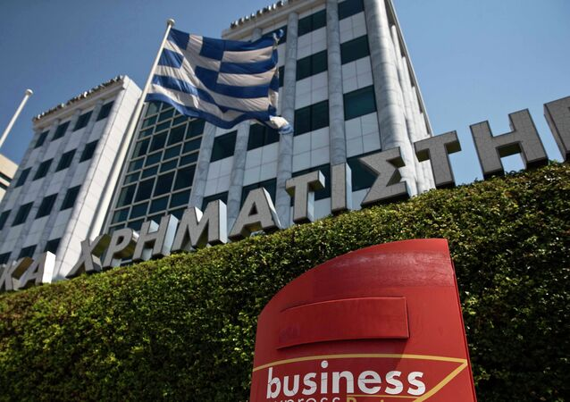 A Greek flag flutters outside the Athens stock exchange , Greece, July 27, 2015