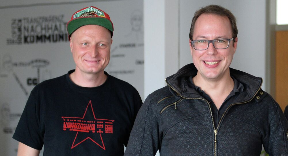 Markus Beckedahl, founder of the website Netzpolitik.org, right, and author of a blog Andre Meister, left, pose in their office in Berlin, Germany