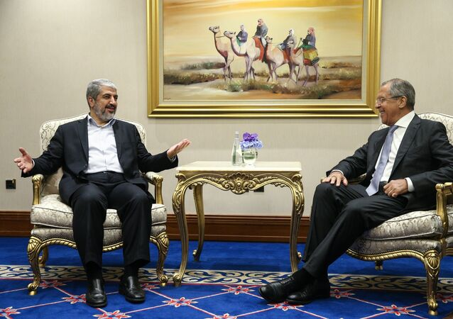 Russian Foreign Minister Sergei Lavrov, right, during a meeting with Chairman of the Hamas Political Bureau Khaled Mashal in Doha