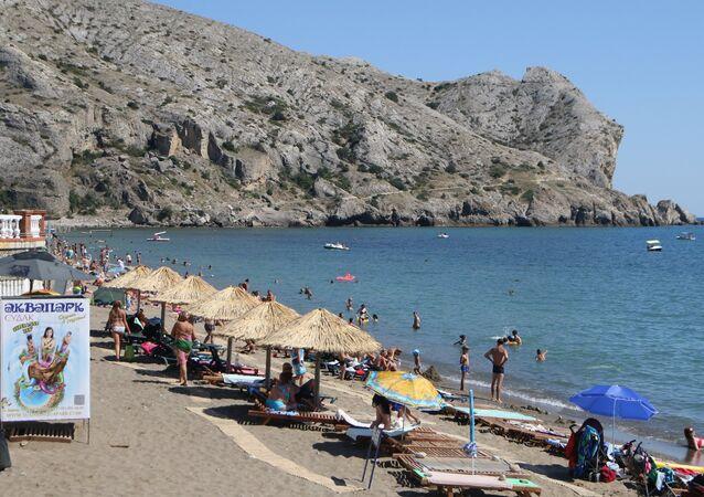 Vacationers on a beach in Sudak, Crimea.