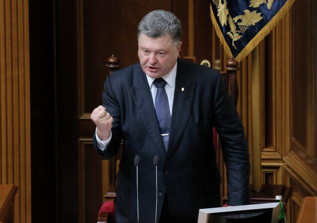 Ukrainian President Petro Poroshenko gestures as he speaks to lawmakers during a parliament session in Kiev, Ukraine