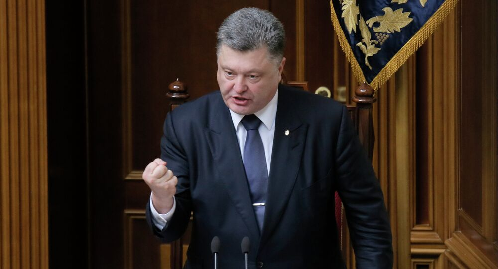 Ukrainian President Petro Poroshenko gestures as he speaks to lawmakers during a parliament session in Kiev, Ukraine