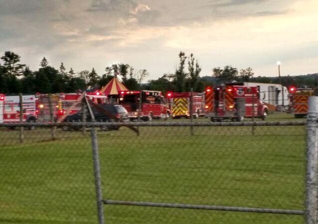 Officers surround the scene of a tent collapse in Lancaster, N.H., Monday, Aug. 3, 2015
