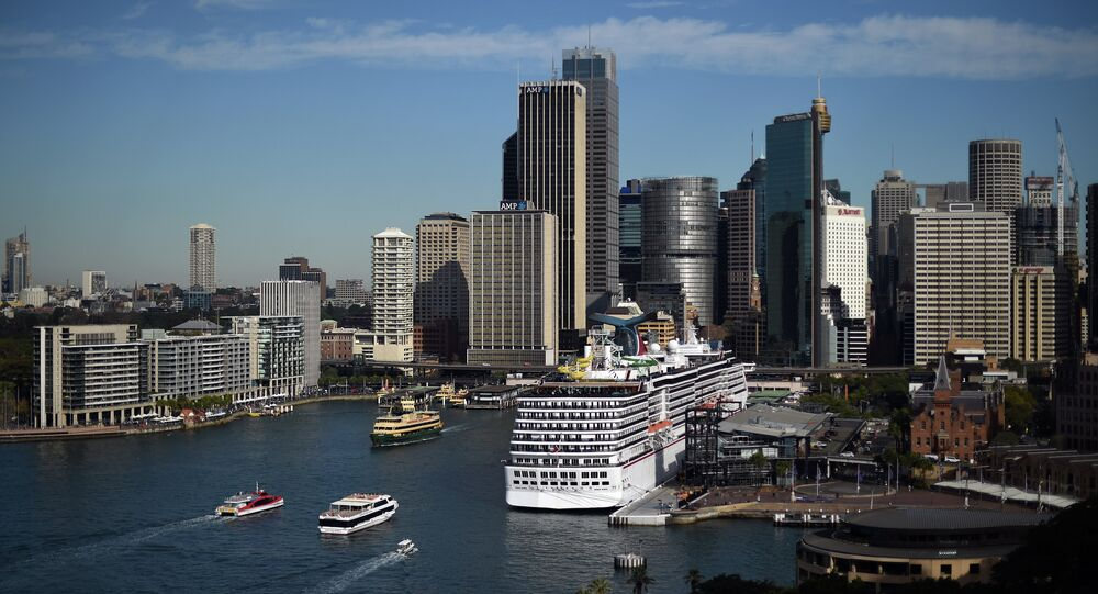 Passenger boats approach Circular Quay ferry wharf in Sydney on May 27, 2015