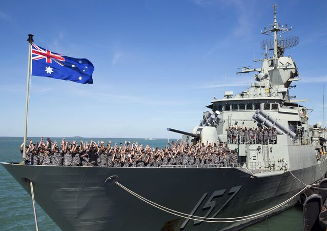 The crew of the Royal Australian Navy Anzac class frigate HMAS Perth cheer as they arrive at the Northern Australian city of Darwin in this picture taken on July 3, 2015