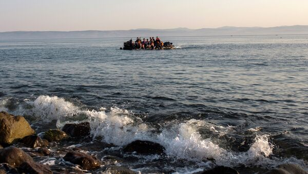Migrants from Syria and Afghanistan arrive on an overcrowded dinghy from the Turkish coasts to the Greek island of Lesbos, Monday, July 27, 2015 - Sputnik International