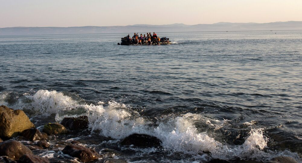 Migrants from Syria and Afghanistan arrive on an overcrowded dinghy from the Turkish coasts to the Greek island of Lesbos, Monday, July 27, 2015