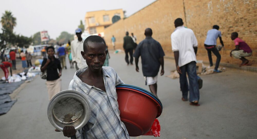 A man sells pots at a marketplace in Burundi's capital Bujumbura, as the country awaits the results of Tuesday's presidential elections, July 23, 2015