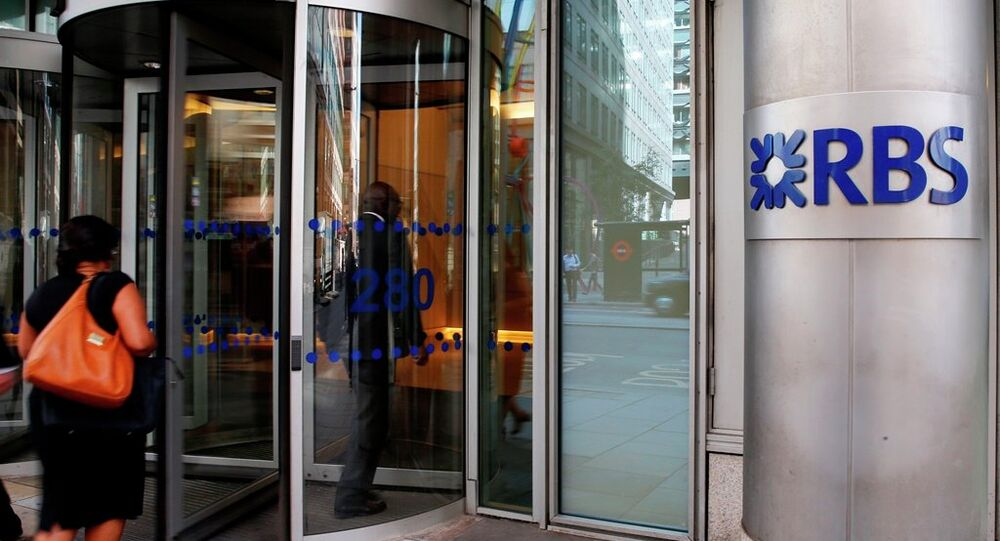 Employees walk into the Royal Bank of Scotland headquarters in the City of London, Tuesday, Aug. 4, 2015.