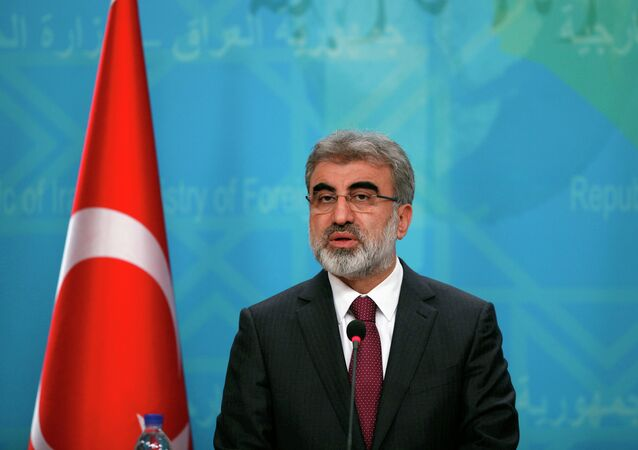 Turkish Energy Minister Taner Yildiz, speaks to reporters during a news conference with Iraqi Foreign Minister Ibrahim al-Jaafari in Baghdad, Iraq, Sunday, Jan. 18, 2015