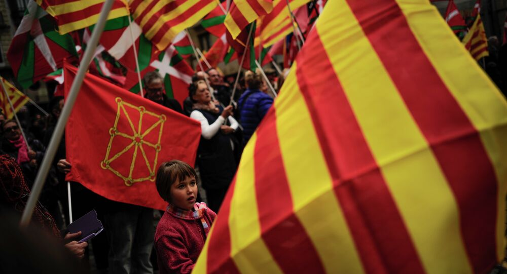 Pro-independence demonstrators of Catalonia and Basque Country raise their regional flags. File photo