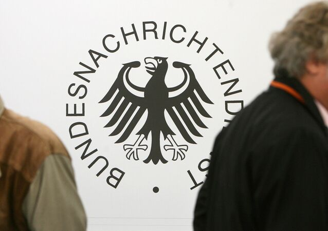 Guests walk past a logo of Germany's intelligence agency the Bundesnachrichtendienst (BND - Federal Intelligence Service) during a ground breaking ceremony for the new national headquarters of the BND in Berlin's Mitte district
