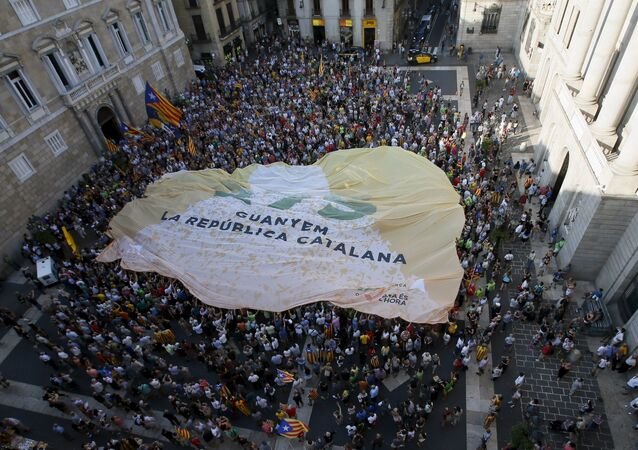 Catalan pro-independence supporters display a giant banner at Sant Jaume square in Barcelona, Spain, August 4, 2015