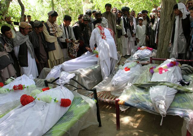 Afghan relatives of the victims of a roadside bomb explosion gather to offer funeral prayers in Ghazni on June 5, 2015