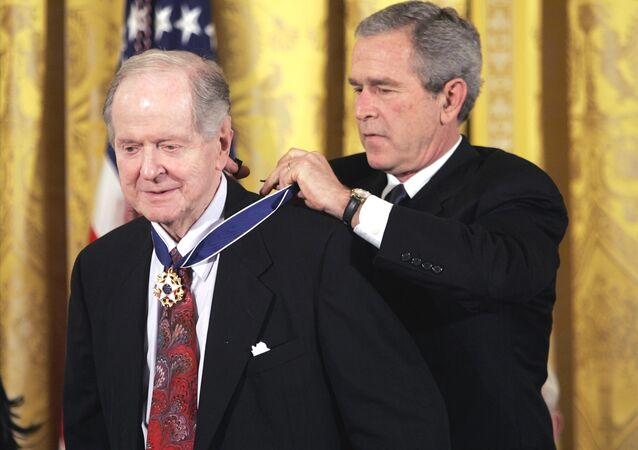 President Bush presents the Presidential Medal of Freedom to historian Robert Conquest. File photo