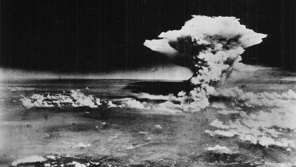 An atomic cloud billows above Hiroshima city following the explosion of the first atomic bomb to be used in warfare in Hiroshima, in this handout photo taken by the US Army on August 6, 1945, and distributed by the Hiroshima Peace Memorial Museum. - Sputnik International