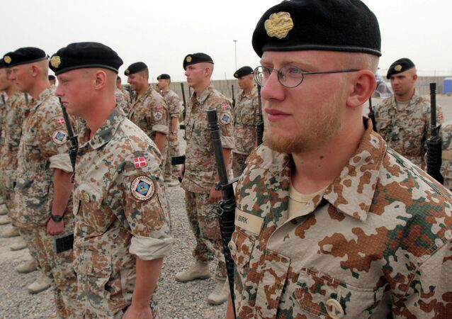 Danish soldiers stand guard during a ceremony to mark transfer of control of a British military base, in Basra, Iraq, Tuesday, April 24, 2007