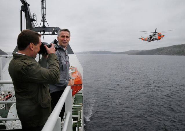 Russia's Prime minister Dmitrij Medvedev (L) and Norway's Prime minister Jens Stoltenberg attend a rescue exercise at the research vessel Helmer Hanssen during the Barents Euroarctic council meeting in Kirkenes, Norway. File photo