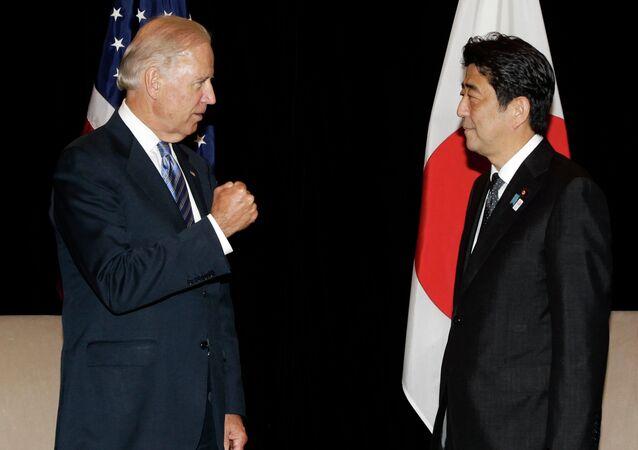 US Vice President Joe Biden, left, and Japan's Prime Minister Shinzo Abe