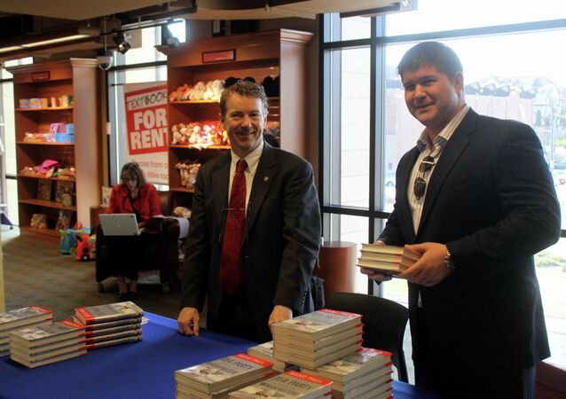 Presidential hopeful Rand Paul of Kentucky at a book signing at Iowa State University in Ames, Iowa, along with Jesse Benton.
