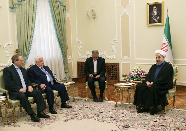Iranian President Hassan Rouhani, from right, speaks with Syrian Foreign Minister Walid al-Moallem as Syrian Deputy Foreign Minister Faisal Mekdad listens during their meeting at the presidency office in Tehran, Iran, Wednesday, Aug. 5, 2015.