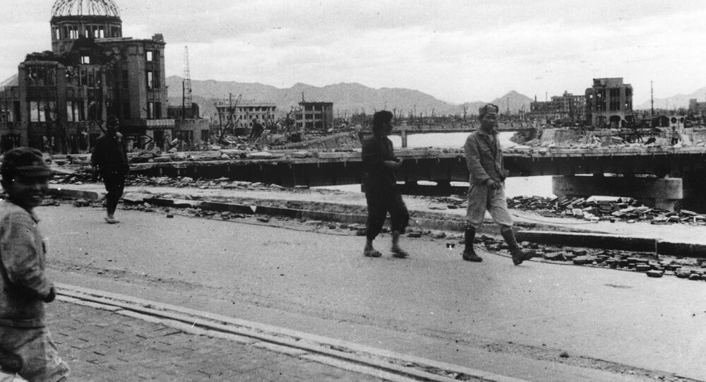 Local residents walk past the gutted Hiroshima Prefectural Industrial Promotion Hall (L), which is currently called the Atomic Bomb Dome or A-Bomb Dome, on Aioi Bridge in Hiroshima after the atomic bombing of Hiroshima on August 6, 1945, in this handout photo taken by Shigeo Hayashi in October 1945 and released by the Hiroshima Peace Memorial Museum.