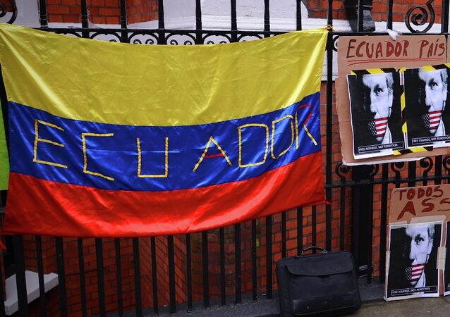 Placard with the slogan We are all Assange written in Spanish below another that reads Ecuador, country of freedom on the railings outside the Ecuadorian embassy in central London on June 21, 2012, where Assange is still holed up seeking political asylum.