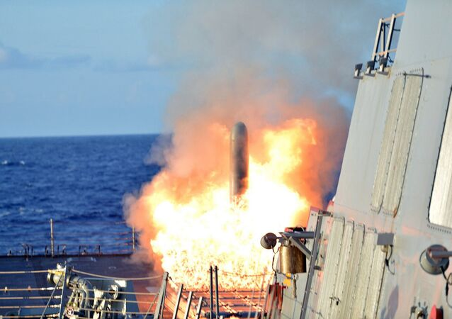 The USS Lassern launches a Tomahawk missile during an exercise with the Japanese Maritime Self Defense Force.