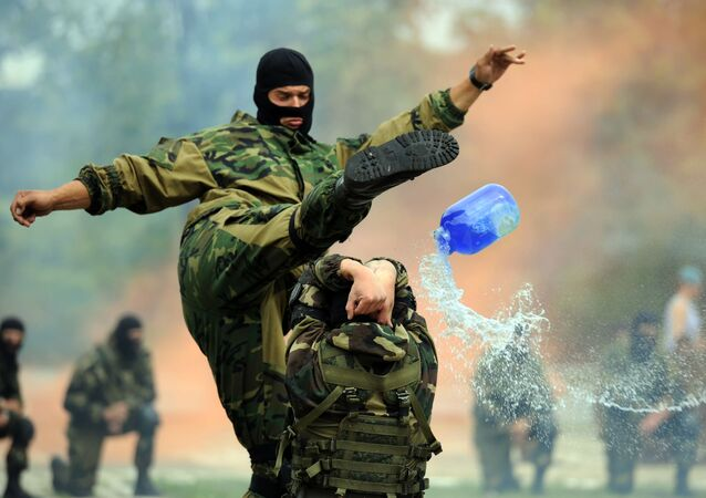 Belarus soldiers of airborne forces perform as they celebrate the Paratroopers' Day in Minsk on August 1, 2015.